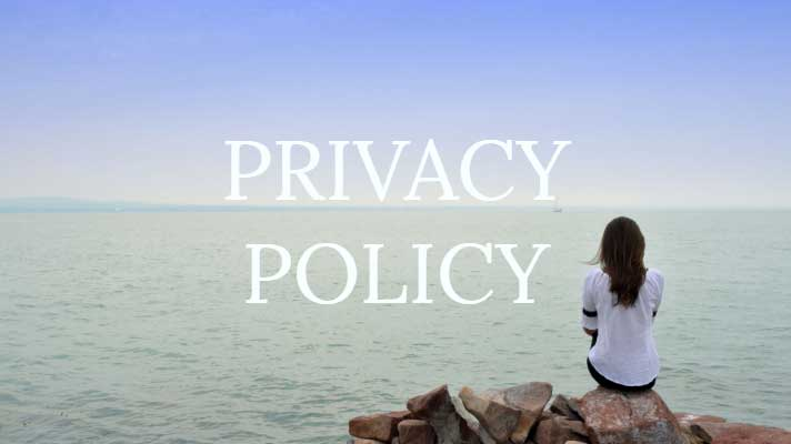 Privacy policy written on image with woman looking out to the sea